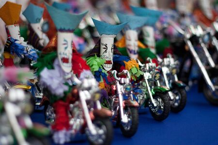 Masked doll on the bike in Thai masked festival photo