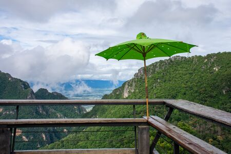 The viewpoint on the mountain has a green umbrella. There are spots for tourists to sit and watch the beauty of the mountains. Reklamní fotografie