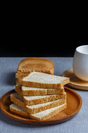 bakery products: Whole Wheat Bread and milk on gray cloth Stock Photo