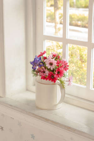 flowers in  vase for decorated home  with sun light photo