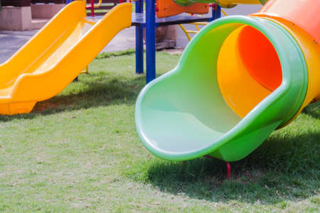 Colorful playground for children in the garden photo