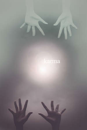 reincarnation: Karma abstract background with hand to hand Stock Photo