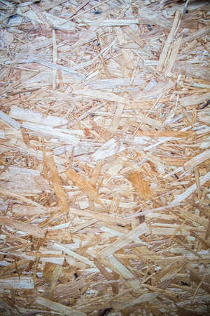 particle: Wood Particle Board. Scraps of wood panel. Wood texture background.