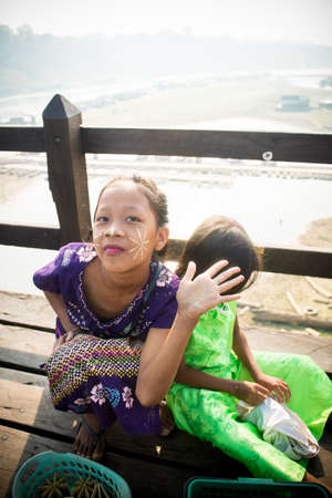 moods: SANGKHLABURI,THAILAND-MAY 2: Funny girl with colorful clothes and many moods on mon bridge. MAY 2, 2016  in Sangkhlaburi, Kanchanaburi, Thailand.