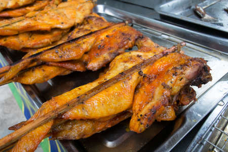 The roasting chicken inserts the wood , delicious food of a Thai