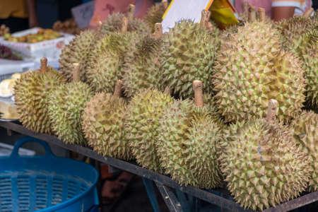 Fresh durian fruit display in street local market for sale in Thailand