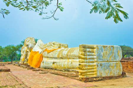 Reclining Buddha at Wat Lokayasutha in Ayutthaya , Thailand Stock Photo