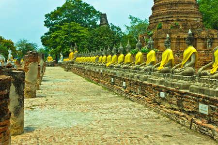 Row of Buddha image at Wat Yai Chaimongkhon in Ayutthaya , Thailand photo