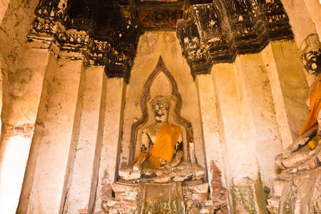 Buddha image at Wat Chaiwatthanaram in Ayutthaya , Thailand photo