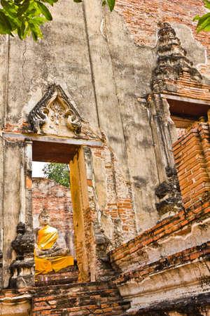 Ubosot and Buddha image of Wat Borommaphuttharam in Ayutthaya , Thailand photo