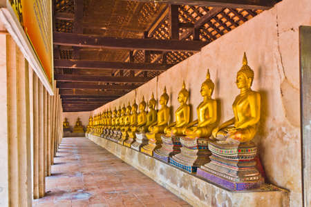 Row of Buddha image at Wat Buddhai Sawan in Ayutthaya , Thailand photo