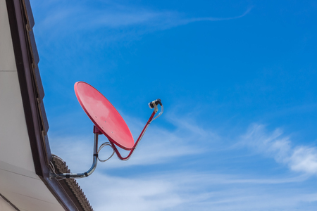 parabolic mirror: Satellite dish on the roof of the house On hot days, that would be great. Stock Photo