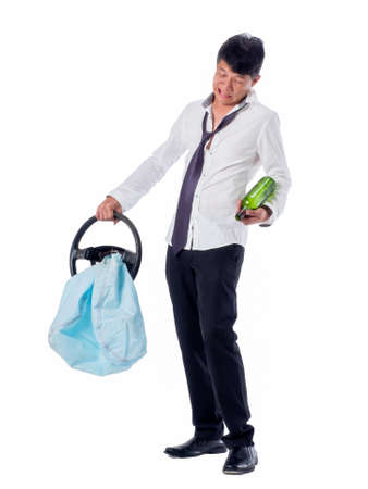 drunk business asia man wear black suit holding wine bottle and steering wheel with air bag on  isolated white background