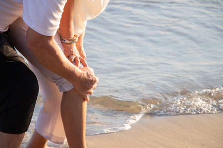 Elderly couples take care of each other while older women suffer from knee pain.