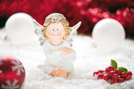 Christmas angel among Christmas balls. photo