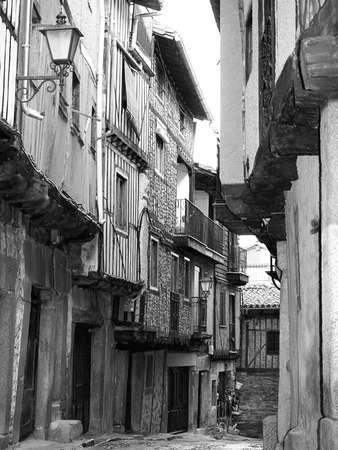 spanish village: A street of La Alberca, Spanish village in black and white Stock Photo