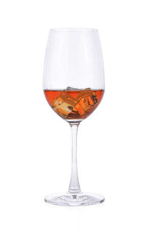 brandy wine glass and ice on white background