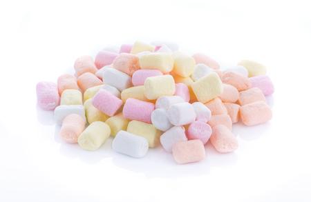 spongy: Marshmallows closeup on white background