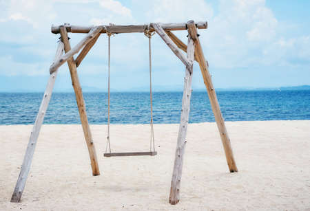 Wooden swing on the beach and Blue Ocean Sea Water Landscape Seascape.,copy space.,Thailand