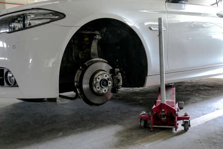 Car lift up for tyre replacement in parking. used floor jack for tyre replacement Stockfoto