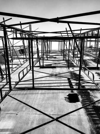 Building under construction. Steel bar or steel reinforcement bar in construction site. Construction crane.Black and White and copy space. vertical Stok Fotoğraf