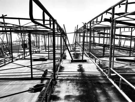 Building under construction. Steel bar or steel reinforcement bar in construction site. Construction crane.Black and White and copy space. horizontal
