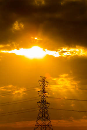 electric pole at sunset Stock Photo