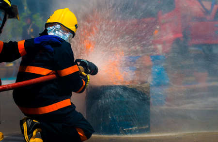 Firemen in a fire-fighting training exercise