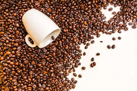 White cup on coffee bean isolated on white background