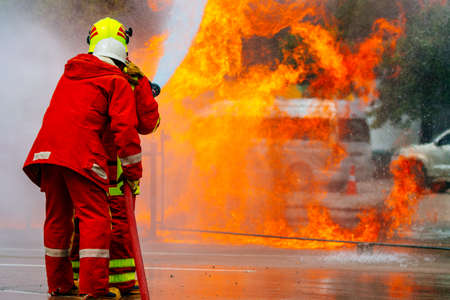 Firefighter fighting For A Fire Attack, During A Training Exercise ,Firefighters training