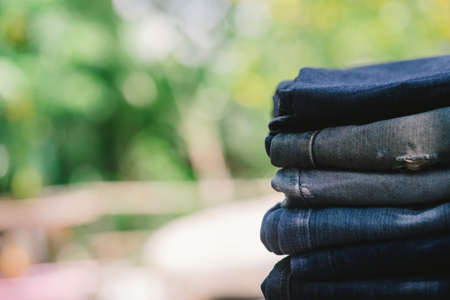 Beauty and fashion, clothing concept - stack of jeans. Stock Photo
