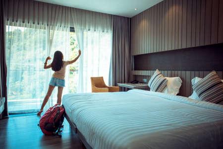 Happy backpacker woman traveller stay in hotel Stock fotó