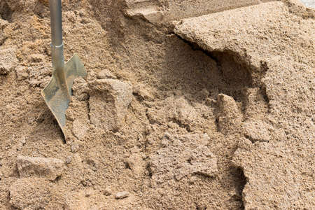 Pile of sand and shovel for construction Stock fotó