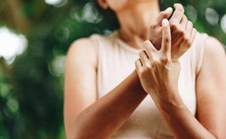 Close up Woman wrist pain Stock fotó