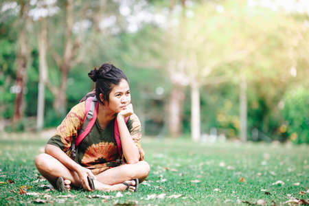 Traveler backpacker asian woman with nature background