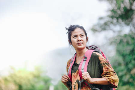 Traveler backpacker Asian woman with nature background , Traveler concept