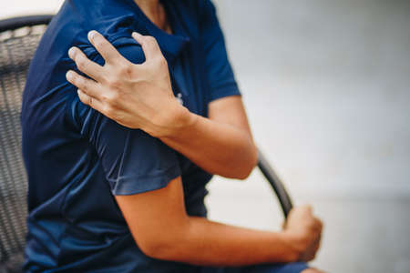 young woman with pain in shoulder, Ache in human body , office syndrome , health care concept