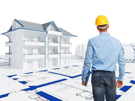A man looks at the house drawings 写真素材