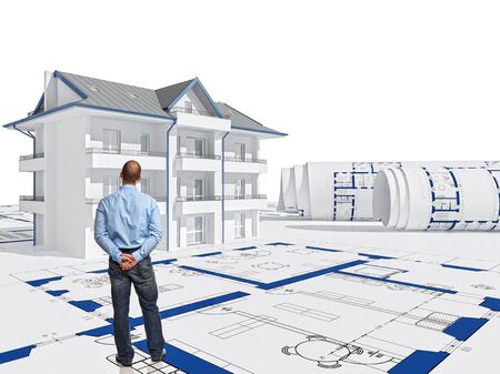 A man stands and looks at the house with drawings