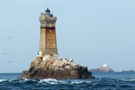 Ancient lighthouse near the sea of the waves