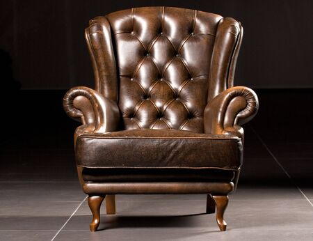 Chair leather brown black background scene antiques