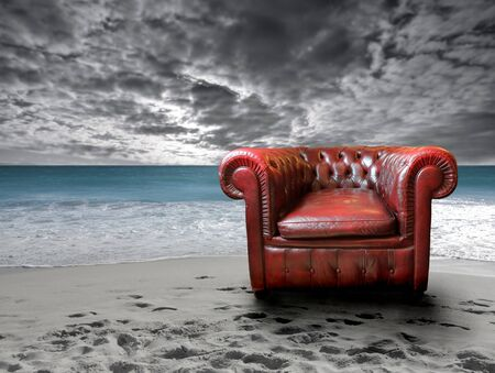 Leather chair against the sea sand sky