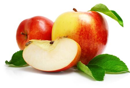 Yellow red apples and a piece on a white background with twigs