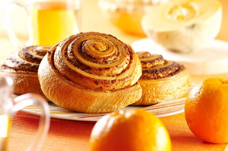 Buns oranges mug plate breakfast table
