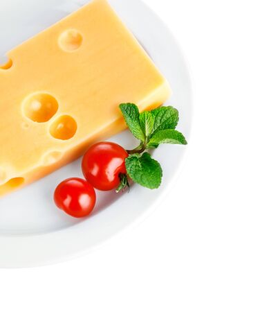 Cheese piece cherry mint plate white background
