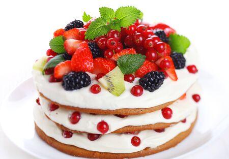Cake cake cream berries currant blackberry strawberry kiwi mint white background Stock Photo