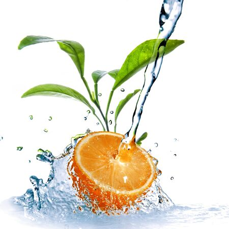 Orange fruit water jet spray leaves on white background
