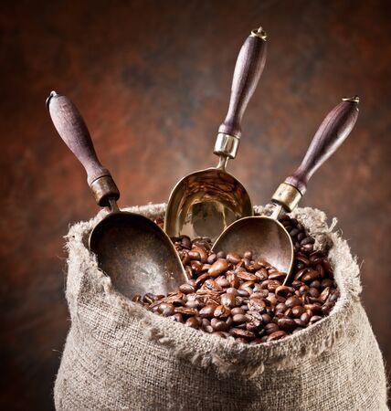 Coffee grains spatula bag brown background