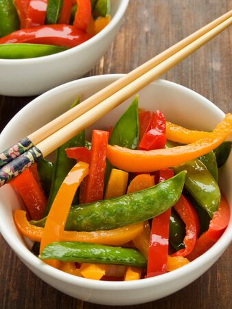 Japanese kitchen dish sticks pepper salad on the table .