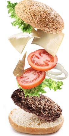 The composition of the hamburger fast food cutlet on a white background .